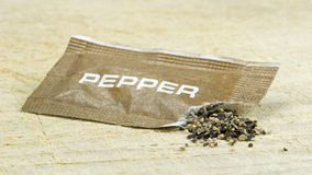 An open sachet of pepper Royalty Free Stock Photo