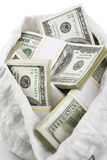 Open sack full of money dollars Stock Photos