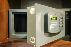 Open safe. Small,open safe in hotel, with LED word CODE Stock Photo