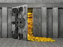 Open safe with a bunch of gold coins Stock Images