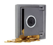 Open safe with coins Royalty Free Stock Images