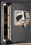 Open safe with keys. Open safe door with keys hanging on front Royalty Free Stock Image
