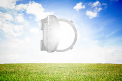 Open safe on sunny landscape background Stock Photo