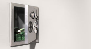 Open Safe On Wall With Australian Dollars. An open metal safe with bundles of australian dollars on a light colored  wall background Stock Photos