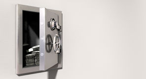 Open Safe On Wall With US Dollars. An open metal safe with bundles of us dollars on a light colored isolated wall background Stock Images