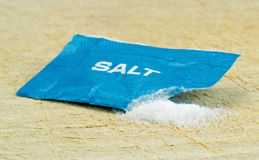 An open salt sachet Royalty Free Stock Photography