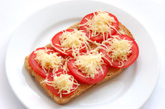 Open sandwich. With tomato on a white plate Royalty Free Stock Images