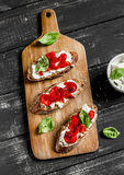 Open sandwich cheese, roasted red sweet peppers and basil Stock Image