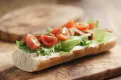 Open sandwich with fried pork, salat and tomatoes on kitchen table Stock Photography