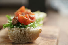 Open sandwich with fried pork, salat and tomatoes on kitchen table Stock Image