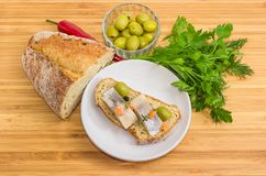 Open sandwich with pickled herring fillet and some ingredients b. Open sandwich made of brown sprouted bread, slices of fillet of pickled Atlantic herring and royalty free stock photography
