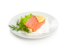 Open sandwich with salmon. Lettuce, lemon and dill Stock Image