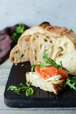 An open sandwich with smoked salmon on toast from homemade bread. Bruschetta, Smrrebrod Stock Images