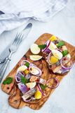 Open sandwich smorrebrod with herring, onion, potato and eggs. Danish open sandwich smorrebrod with herring, onion, potato and eggs Royalty Free Stock Image