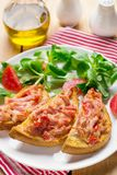 Open sandwich tartine with tomato, ham and cheese royalty free stock image