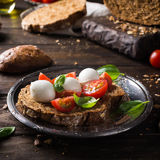 Open sandwich with tomato, mozzarella and basil Stock Photos