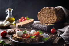 Open sandwich with tomato, mozzarella and basil Royalty Free Stock Photography