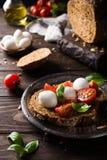 Open sandwich with tomato, mozzarella and basil Stock Photography