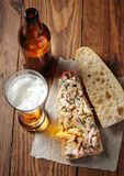 Open sandwiches with chicken and beer. Open sandwiches with chicken, vegetables and mayonnaise salad Royalty Free Stock Images