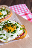 Open sandwiches with egg and cheese on a wooden background Royalty Free Stock Photos