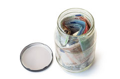 Open saving money jar. Stock Photos