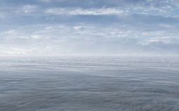 Open Sea With Cloudy Sky And Misty Horizon Royalty Free Stock Image