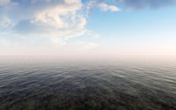 Open Sea With Cloudy Sky And Misty Horizon Royalty Free Stock Photo