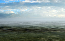 Open Sea With Cloudy Sky And Misty Horizon Stock Photo