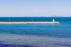 Open Sea Jetty And Islands On A Bright Day Royalty Free Stock Photography