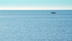 Open sea with ship on the horizon stock footage