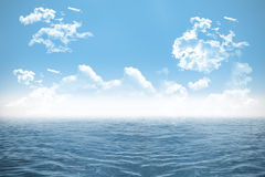 Open sea under cloudy blue sky Royalty Free Stock Image