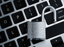 Open security lock on computer keyboard Royalty Free Stock Images