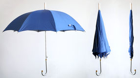Open,semi-open,close. Three states of a blue umbrella Royalty Free Stock Photo