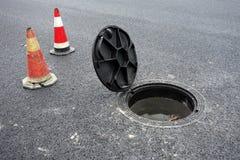 Open sewer manhole