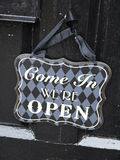 Open shop sign. Come in we're open sign on outside shop door Royalty Free Stock Photos