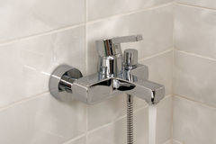 Open shower faucet royalty free stock image