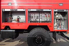 Open side with the equipment of modern fire engine Royalty Free Stock Photo