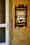 Open Sign 1. Welcoming Open sign on store in historic building in Bishop Hill, Illinois Stock Photo
