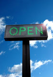 Open Sign. A light signpost highlighting 'Open' in green lights Stock Photography