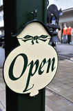 Open Sign. A Sign outside a small shop in a mall saying that its - Open Royalty Free Stock Images