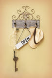 Open Sign. Hanging next to a key and hat royalty free stock photography