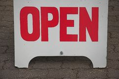 Open sign. Pavement sign indicating enterprise open Royalty Free Stock Image