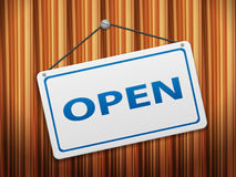 Open sign board. On wood background Royalty Free Stock Photo