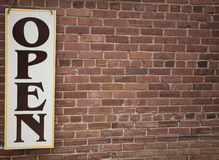 Open Sign and Brick Wall Royalty Free Stock Image