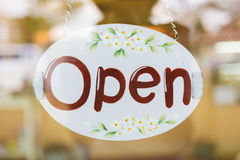 Open sign broad hanging on mirror door Stock Image