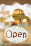 Open sign broad hanging on mirror door Royalty Free Stock Photos