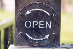 Open sign on canal lock gate Stock Photos
