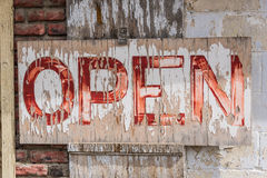Open sign with flaking paint Royalty Free Stock Photo