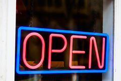 Open sign. Glowing open neon sign in a window Royalty Free Stock Photography