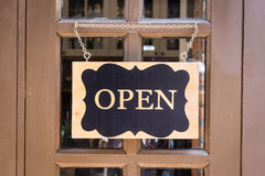 Open sign hanging on deluxe door Royalty Free Stock Image